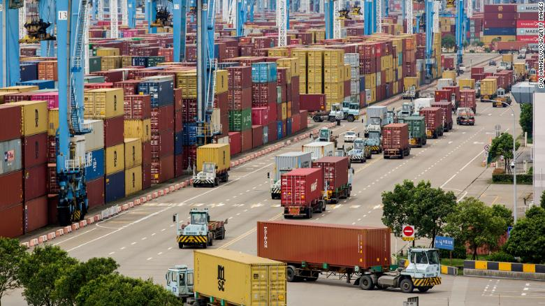 NINGBO, CHINA - AUGUST 15: Containers are seen transported at Ningbo-Zhoushan port on August 15, 2021 in Ningbo, Zhejiang Province of China. (Photo by Suo Xianglu/VCG via Getty Images)
